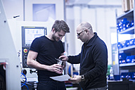 Two men at work in a factory - SGF02084