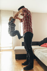 Father and son playing together at home - ZEDF00492