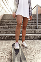 Legs of young woman with skateboard - MGOF02774