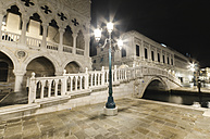 Italy, Venice, bridge over canal at night - DHCF00029