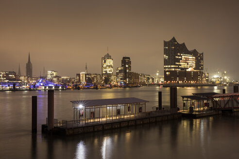 Germany, Hamburg, view to skyline with Hafencity and Elbe Philharmonic Hall at night - WI03385