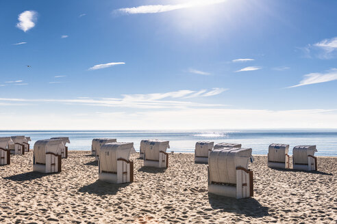 Germany, Schleswig-Holstein, Bay of Luebeck, hooded beach chairs on the beach - EGBF00170
