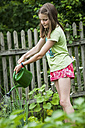Girl watering vegetables in the garden - PAF01742