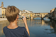 Italy, Tuscany, Florence, Boy taking pictures Ponte Vecchio - PAF01745