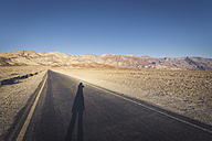 USA, California, Death Valley, Artist's Drive with woman's shadow at sunset - EPF00237