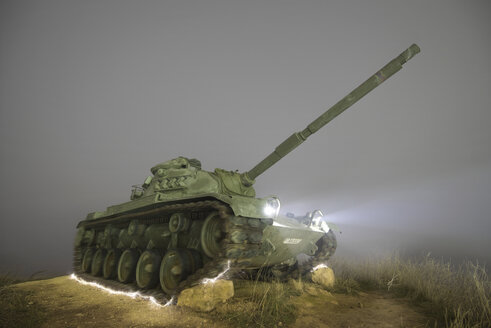 Spain, Burgos, misty night scene of an abandoned Military war tank - DHCF00042