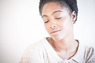 Portrait of young woman with eyes closed - SIPF01290