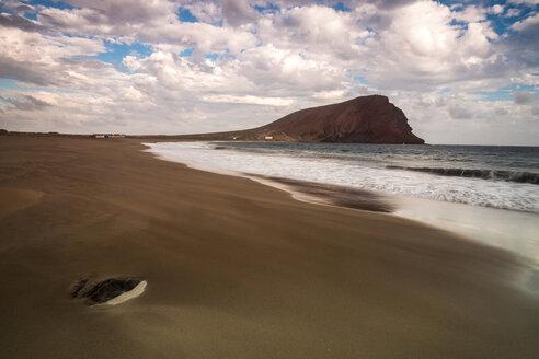 Spain, Tenerife, beach La Tejita with Montana Roja in the background at sunset - SIPF01294