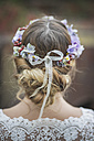 Close-up of bride wearing floral hair wreath - ASCF00696