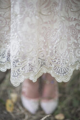 Close-up of bride wearing lace dress - ASCF00699
