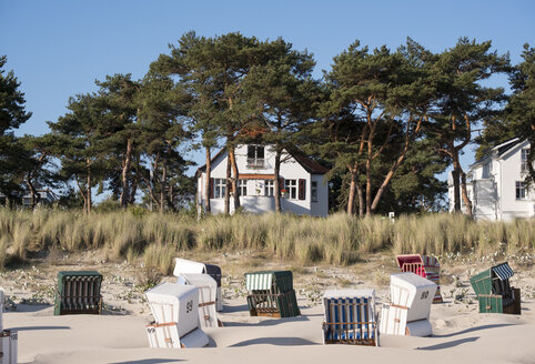 Germany, Usedom, Bansin, hooded beach chair on the beach - SIE07251