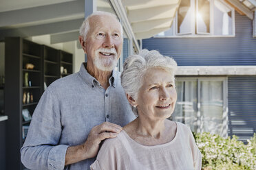 Senoir couple standing in their home, looking confident - RORF00489