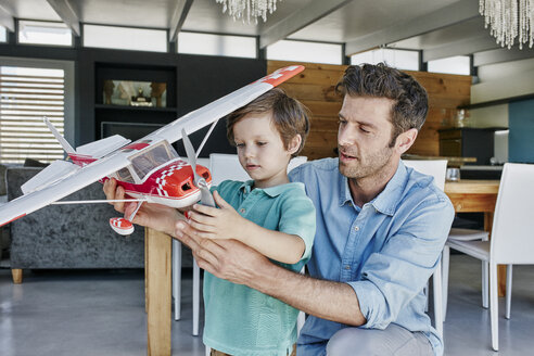 Father and son playing with toy airplane - RORF00498