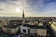 Germany, Munich, cityscape with St. Peter's church at dusk - THA01886