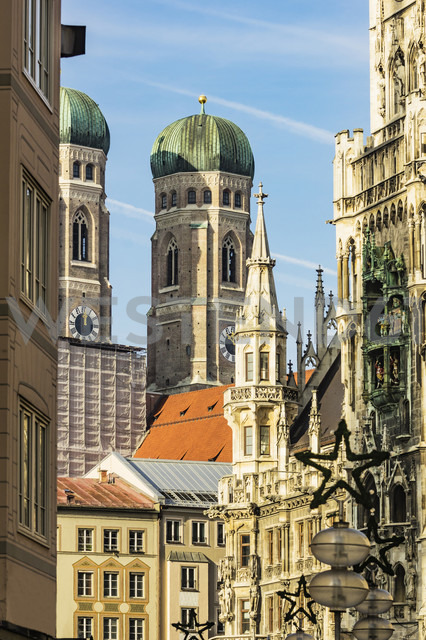 Germany, Munich, view to spires of Cathedral of Our Lady with town hall in the foreground - THAF01895