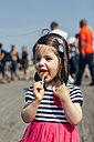 USA, New York, Coney Island, little girl with lollipop - DAPF00547