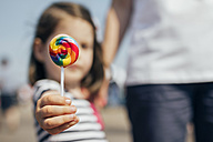USA, New York, Coney Island, little girl's hand holding lollipop, close-up - DAPF00550