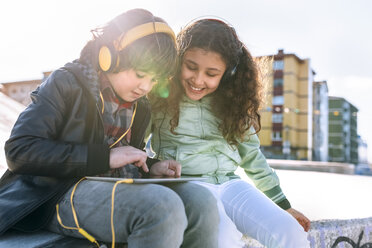 Two children with headphones and tablet - MGOF02792