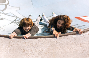 Two children playing in a skatepark - MGOF02801