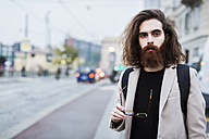 Portrait of stylish young man in the city - MAUF00946