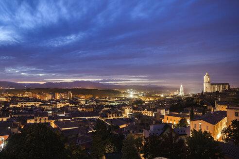 Spain, Girona, city view at evening twilight - ABOF00150