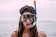Young woman with diving goggles and snorkel pulling funny faces - WVF00780