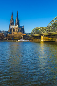 Germany, Cologne, view to Cologne Cathedral with Hohenzollern Bridge and Rhine River in the foreground - MHF00406