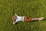 Teenage boy lying in grass - PAF01753