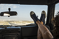 Woman sitting in car with feet up on dashboard - SIPF01323