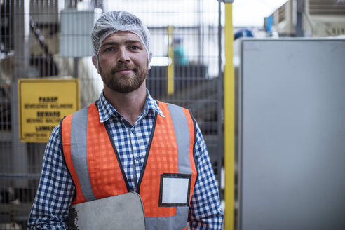 Portrait of confident inspector in factory - ZEF12440