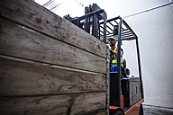 Man on forklift in warehouse - ZEF12443