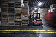 Man on forklift in factory hall - ZEF12455