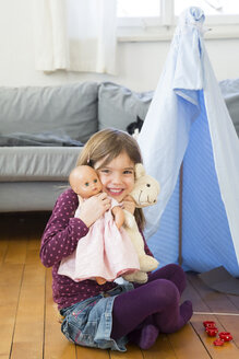 Portrait of happy little girl with her toys at home - LVF05792