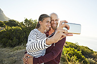 Portrait of couple in love taking selfie with smartphone - SRYF00222
