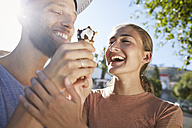 Young couple with ice cream cone - SRYF00252