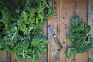 Kale leaves and pocket knife on wood - LVF05798