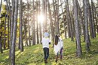Family with two girls walking in forest - HAPF01294