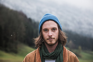 Portrait of bearded young man in autumn wearing blue cap - WVF00810