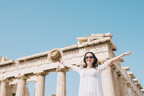 Greece, Athens, happy woman visiting the Parthenon temple on the Acropolis - GEMF01411