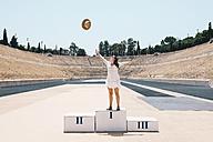 Greece, Athens, woman on the podium celebrating in the Panathenaic Stadium - GEMF01420