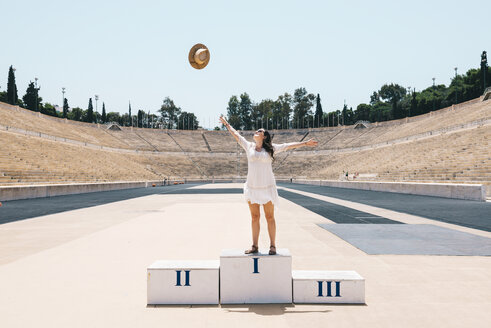 Greece, Athens, woman on the podium celebrating in the Panathenaic Stadium - GEMF01420
