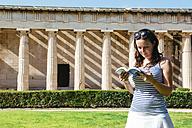 Greece, Athens, woman reading a book in front of The Hephaisteion in the Agora - GEMF01441