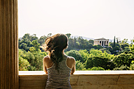 Greece, Athens, woman looking to the Hephaisteion from Stoa of Attalos in the Agora - GEMF01444