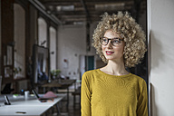 Portrait of smiling woman in office - RBF05596