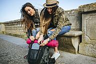 Two young women on a trip having a break - KIJF01116