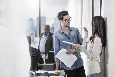 Colleagues talking in modern office - ZEF12502