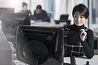 Woman working on computer at desk in office - ZEF12535