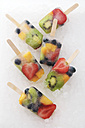 Six fruit ice lollies with fresh fruits on white ground - RTBF00611