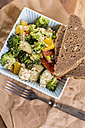 Bowl of mixed raw salad and slice of bread - JUNF00794