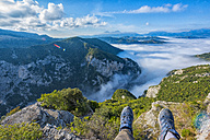 Italy, Marche, Apennines Mountains, Furlo Pass, feet of resting hiker on top of mountain - LOMF00495